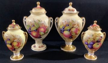 A pair of Aynsley Orchard Gold pattern pedestal two-handled vases and covers; another pair