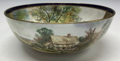 A Durley bowl, painted by James Skerrett, signed, the interior decorated with a Tudor style