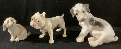 A Danish Bing and Grondahl model of a terrier, seated, 9cm high, number 2027, printed mark; a
