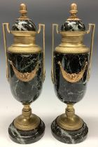 A pair of French Empire style marble and gilt brass two handled urns, acorn finials, 36.5cm