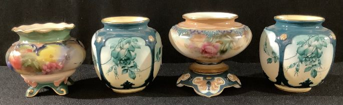 A pair of Hadley's Worcester faience ovoid vases, printed with leafy green trailing blossom, 8.