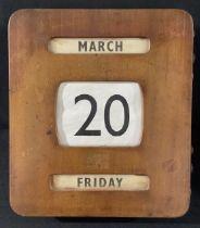 An Art Deco rounded rectangular wall-hanging perpetual calendar, 30.5cm x 27cm, c. 1930