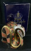 A Royal Crown Derby paperweight, Imari snake, decorated in the 1128 pattern, gold stopper, first