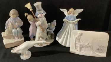 A Llardo figure group the snowman, with children and puppy, 5713, 21cm, printed mark; others,