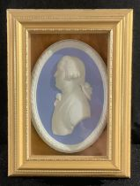 A Wedgwood Jasperware oval plaque, 18th century gent in profile, 11cm, framed in a gilt box frame,