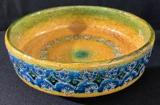 An Italian stoneware art pottery bowl by Nuovo Rinascimento, impressed and glazed in shades of