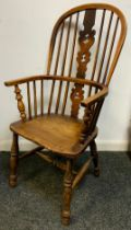 A 19th century Windsor chair, pierced splat, turned legs. H stretcher, 110cm high.