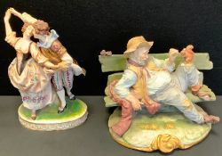 A Capodimonte figure, Dancing Companions, crowned N marks, 25cm high; another Bruno Merli, Tramp