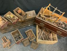 Tools and fixings; vintage coping, veneer, and tenon saws, wood carving chisels, woodworking vice,