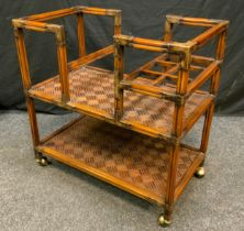A Reproduction Oriental Style, Walnut, 'Butler's' Trolley, reeded square supports, brass ball-