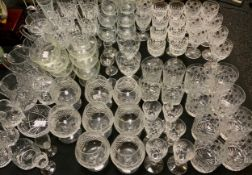 A set of eight cut glass brandy glasses; eight large whisky tumblers; others smaller; wine