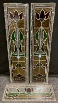 A Pair of Stained Glass Panels, with 'Art Nouveau' stylised Roses, in red, green, and yellow