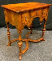 A reproduction walnut lowboy, rectangular top above one short and two deep cockbeaded drawers,