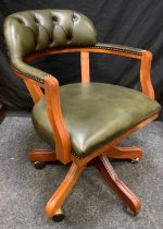 A 20th century faux green leather swivel office chair