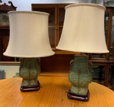 A pair of modern Chinese archaic bronzed vases, as side lamps, in green verdigris, 43cm high