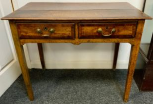 A George III oak low boy, rounded rectangular over sailing top, above a pair of short drawers, brass