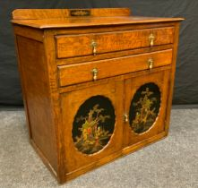 An Early 20th century oak cabinet chest, two long drawers above a pair of cabinet doors with
