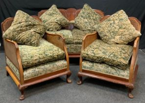 A Queen Anne style mahogany bergere drawing room suite, comprising a two seater and two single