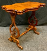 A reproduction Victorian style walnut centre table, shaped top, lyre supports, turned stretcher,