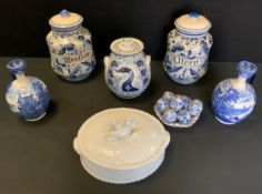 A pair of Cauldon blue and white flasks decorated with Romano Grecian landscapes, 22cm high; Menthoy
