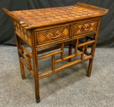 A Reproduction Oriental Style walnut Hall table, carved sleigh-form top above a pair of short