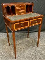 A 20th century George III style reproduction mahogany Bonheur du Jour, having three small drawers,