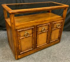 A Contemporary 'Drexel' style, walnut side table/cabinet, rounded rectangular oversailing top with