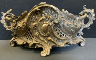 A 19th century silver metal French rococo scrolling jardinière, 20cm high, 46cm wide.