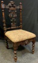 A Victorian Gothic Revival Side Chair, c.1880, 102cm tall.