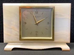 A 20th century Olivant and Botsford Elliot onyx time piece, silvered square dial, Arabic numerals