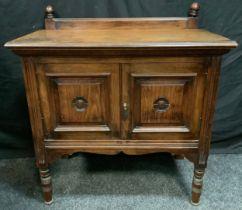 An Art & Crafts small oak sidetable, half gallery, rectangular top above a pair of cupboard doors,