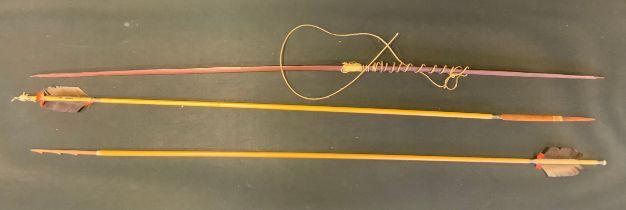 An Amerindian Guyana hunting set, harpoon arrow, animal arrow and launcher, each approx 108cm