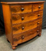 An Early Victorian Mahogany Bow Front Chest of Drawers, two short, over three long, graduated