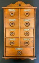 A 19th century oak wall hanging spice rack with an arrangement of drawers.47cm high, 25cm wide.