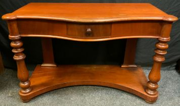 A Victorian Mahogany Serpentine Buffet side-table, single small drawer to front, turned supports,