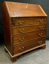 A Late Victorian Mahogany Bureau, fall top enclosing two small drawers and pigeon holes, over four