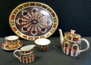 A Royal Crown Derby miniature bachelors tea set on tray, inc teapot, milk jug, sugar bowl, cup,