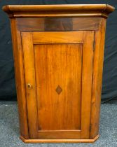 A 19th century oak wall hanging splay front corner cupboard, moulded cornice above a rectangular