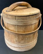A Wooden stave built tapering pail and cover, with handle, 31cm high.