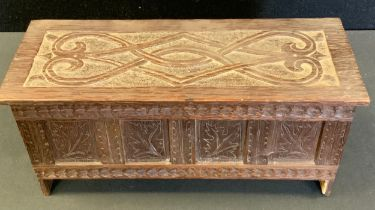 Miniature Furniture - a carved blanket box, scrolled plank top, leaf carved four panel front,