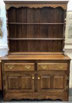 A Griffiths oak dresser, as bespoke made for Harrods in 1977, 181cm tall x 121.5cm.