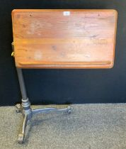 A Daytona Florence Victorian style pine and cast iron reading stand, telescopic stand, paw feet,