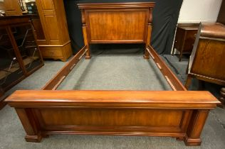 A King Size Mahogany bed frame.