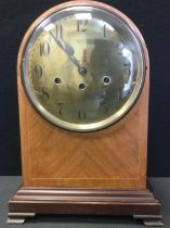 A late 19th century Junghans inlaid mahogany domed bracket clock, brass dial, Arabic Numerals, eight