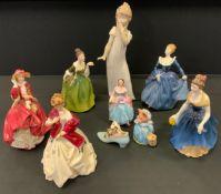 A Royal Doulton figure Fleur, Hn 2368; others Melanie Hn2271, Fragrance, Hn 2334, Top o The Hill, Hn
