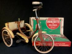 A Tri-Ang tricycle; a Chad Valley Soccer football game, boxed; a Merit Snookerette & Billiards