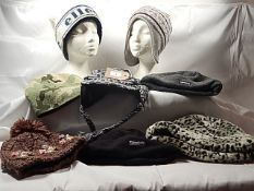 8 hats to include Ellesse, Thinsulate, Airwalk, and a Faux fur hat. (mannequin heads not included)