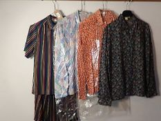 A collection of vintage shirts/blouses to include Rodier Paris size 12 skirt and blouse combo, 3 x