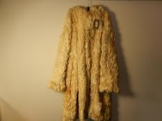 A vintage 1970's ? Sheep skin/fleece coat very heavy, with hood. No makers label