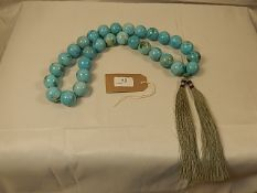 An Oriental style set of heavy turquoise beads by Oka interior company